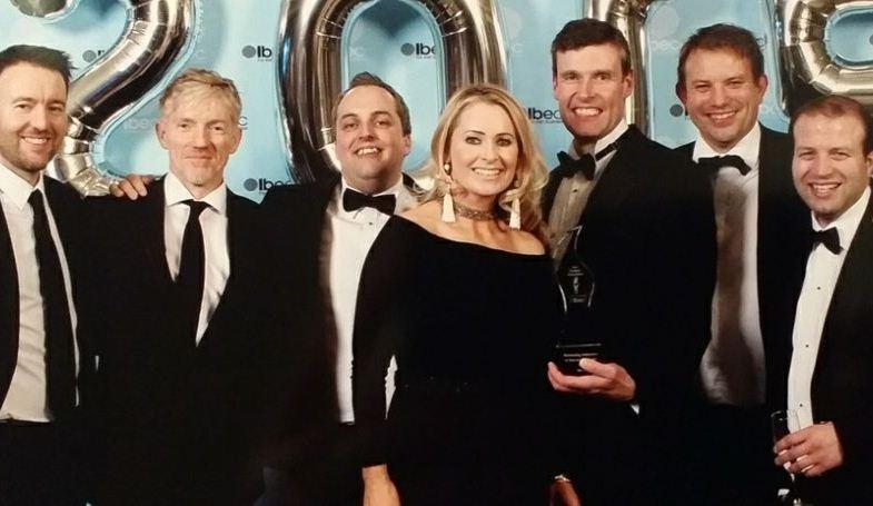 Asavie execs (from left) Ronan Boylan, Hugh Carroll, Dylan Fermoyle, Tom Maher, Jars Jerkland and Barry Carroll with awards MC Sharon Ní Bheoláin